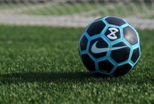 blue and black Nike soccer ball