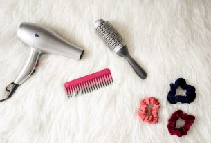grey-hair-blower-near-pink-hair-combs-and-scrunchies